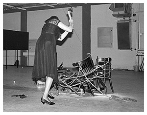 Performance And this ladies and gentlemen was the destruction of six Thonet- chairs tied with a rope into a circle and several eggs (1984) in De Fabriek Eindhoven. foto Peter Cox.